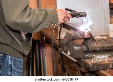 Industrial welder working a welding metal. Closeup photo