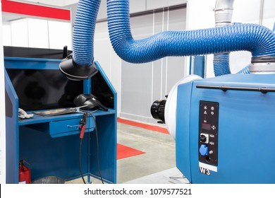 Industrial welding equipment  workshop with welding fume and dust extractor.