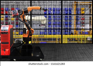 Industrial welding robot in production line of high technology manufacturer factory site