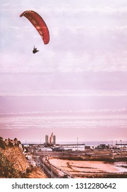 The industrial west cliff side of Ramsgate royal harbour, Kent, UK  as a paraglider flies overhead