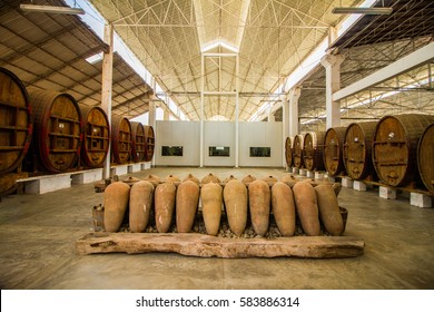 Industrial wine and pisco production,Large barrels, and ceramic vases  at vineyards near Ica, Peru