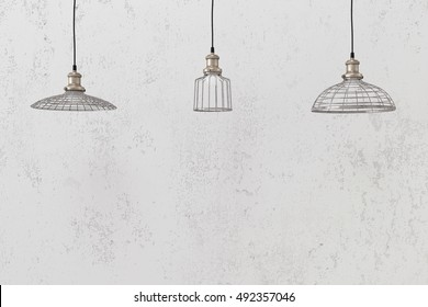 Industrial wire pendant lamps against rough wall