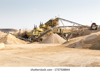 Industrial work processing of stones with a gravel crusher and sorter machinery