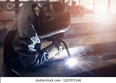 Industrial Worker Cutting and Drill Steel Beam in the Factory.