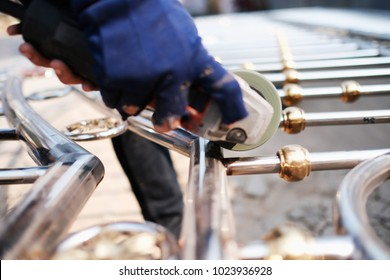 Industrial worker cutting and welding metal