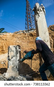 Industrial worker details. Male worker using jackhammer , pneumatic drill machinery
