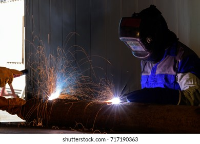 Industrial Worker at the factory welding close up .