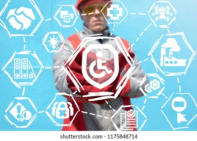 Industrial worker offers a shield with disabled icon on a virtual panel. Industry disability insurance. Preventing injuries on a heavy manufacture. Safety work regulations manufacturing concept.
