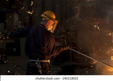 Industrial worker on iron melting plant