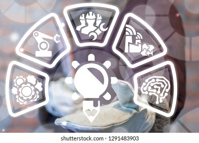 Industrial worker represents a bulb pencil icon on a virtual interface. Industry 4.0 creative innovation development concept. Creativity industrial construction and designing technology. Education.