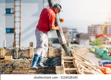 Industrial worker using concrete pipe pump for building house