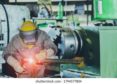 Industrial Worker welding steel pipe line by Tig gass welding