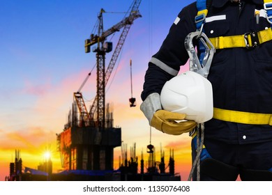 Industrial worker working at height equipment wearing safety harness and safety line working.