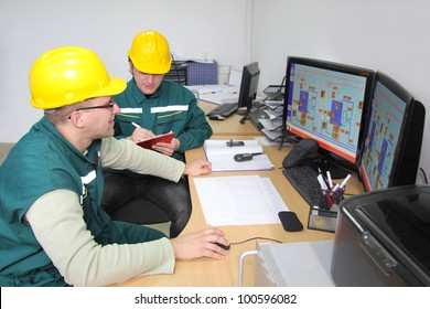 Industrial workers working in a control room