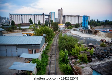 Industrial zone of a city with grain elevator and railway