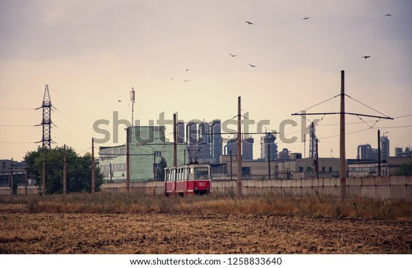 Industrial zone with lonely tram. Coke chemical factory. Avdeevka, Ukraine.