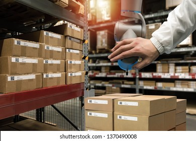 Industry 4.0, 5.0 Collaborative robot technology Concept. Smart logistic , QR Codes Asset warehouse and inventory management supply chain technology concept. Group of boxes in storehouse check pickup.