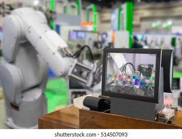 Industry 4.0 and Augmented reality for industry concept. Robotic and Automation system control application on computer screen on automate robot arm in smart manufacturing background.