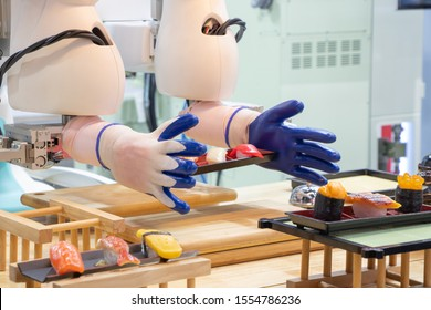 Industry 4.0 Automatic technology robot concept, artificial intelligence, Future Restaurant,  Robotic arm preparing japanese food on a plate to serve.