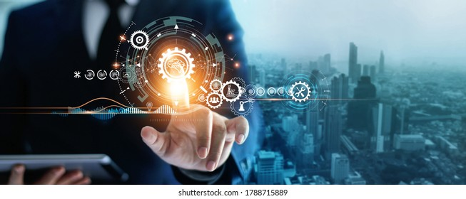 Industry 4.0, Businessman touching brain in cogwheel, Innovative and futuristic, Business process workflow development and optimisation of construction industrial on city background.