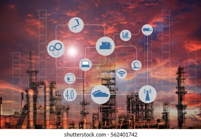 Industry 4.0 concept image.Oil refinery at twilight with cyber and physical system icons diagram on industrial factory and infrastructure background.