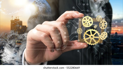 Industry 4.0 , Machine learning and artificial intelligence concept. Man suit hand holding Ai chipsets and 3d rendering gears with flare light effect