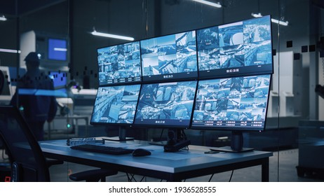 Industry 4.0 Modern Factory: Security Control Room with Multipoke Computer Screens Showing Surveillance Camera Footage Feed. High-Tech Security