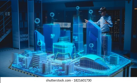 Industry 4.0: Modern Professional Architect Wearing Virtual Reality Headset Uses Gestures to Design, Manipulate Buildings for 3D City. Mixed Augmented Reality Software. VFX Graphics Effect