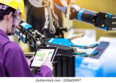 Industry 4.0 Robot concept .Engineers use laptop computers for machine maintenance, automation tools, robot arm at the factory.