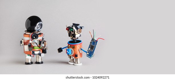 Industry 4.0 service repair maintenance concept. Creative design robotic handyman characters on gray background. Copy space
