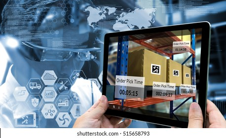 Industry 4.0,Augmented reality and smart logistic concept. Hand holding tablet with AR application for check order pick time in smart factory warehouse.Man use AR glasses and infographic background.