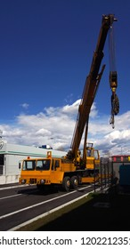Industry background. Mobile crane truck and blue sky
