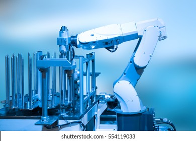 Industry concept and blue tone of automated robot arm in production line of smart factory