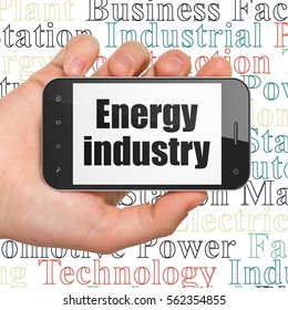 Industry concept: Hand Holding Smartphone with  black text Energy Industry on display,  Tag Cloud background, 3D rendering
