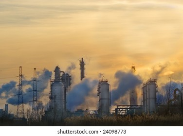 Industry at dawn with smoke