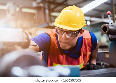Industry factory maintenance engineer wearing uniform and safety helmet under inspection and checking production process on factory station on machinery. Industry, Engineer, construction concept.
