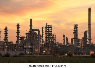 oil​ refinery​ and​ petrochemical​ plant​ industry, refinery​ factory, natural​ gas​ storage​ tank, silhouette​ petroleum​ industrial​ at​ yellow​ sunrise​ sky​ background​