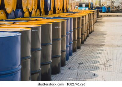 Industry oil barrels or chemical drums stacked up.chemical tank.container of  barrels of hydrocarbons.hazardous waste of black and blue tank oil.