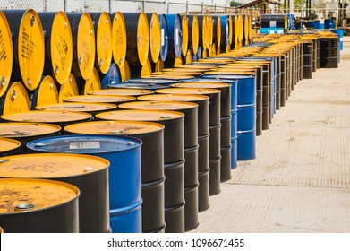 Industry oil barrels or chemical drums stacked up. Oil Barrels.Stack Of Oil barrels in plant.