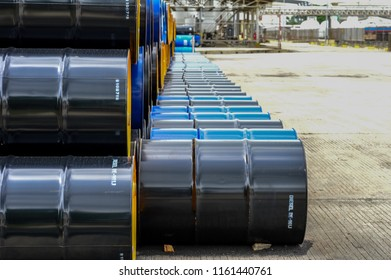 Industry oil barrels or chemical drums stacked up.chemical tank.container of  barrels of hydrocarbons.Chemical reagents.hazardous waste of black and blue tank oil.