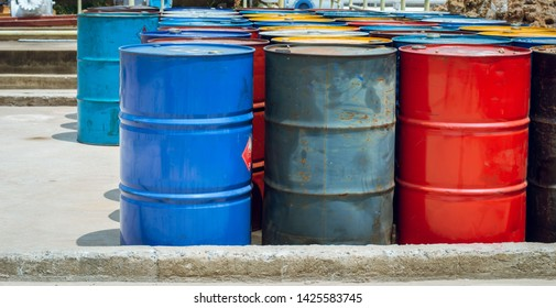 Industry oil barrels or chemical drums stacked up.chemical tank.container of  barrels of hydrocarbons.Chemical reagents.hazardous waste of red and blue tank oil.