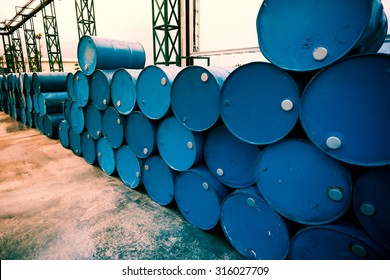 Industry oil barrels or chemical drums stacked up. Fillter image processed.