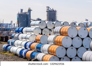 Industry oil chemical metal barrels stacked up in waste yard of tank and container, Kawasaki city near Tokyo Japan