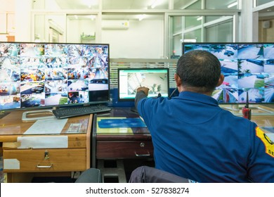 industry Security System. - Control room operator. Security video surveillance with observer and screen monitor .