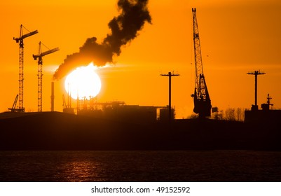 Industry silhouettes, pollution and big yellow sun