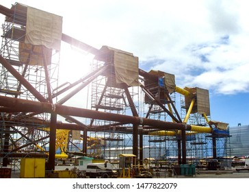 Industry Structural parts of oil and gas rig during construction site in the port yard and workers preparing to move into the vessel to be installed in offshore locations.  - image Film grain effect