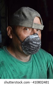Industry worker face with greasy dust mask and oil.