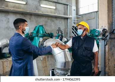 industry workers. safety handshake due covid virus