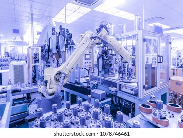 Industry4.0 concept .A moving manipulator in an intelligent factory.heavy automation robot arm machine with  Real-time display status of electronic screen.