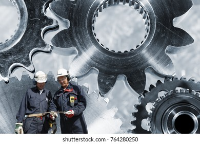 Industry-workers, engineers with large titanium gears mchinery